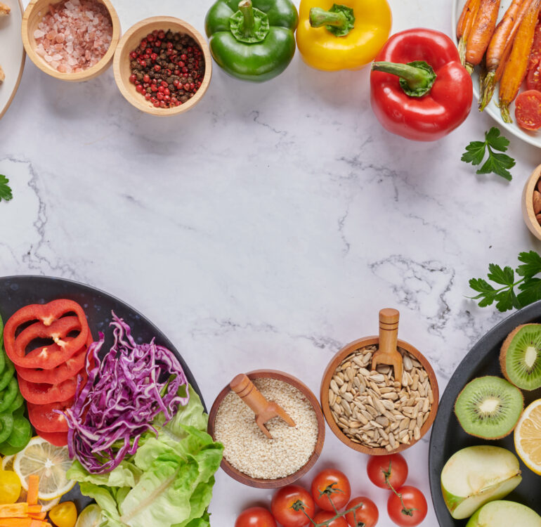 Vegan protein source. Buddha bowl dish, avocado, pepper, tomato, cabbage, chickpea, toast, bread fresh lettuce salad and walnuts, nuts, beans. Healthy vegetarian eating, super food. Top view.